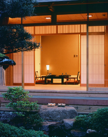 A private look into a ryokan bedroom. Photo taken from the private outdoor Japanese garden of the room, looking inwards