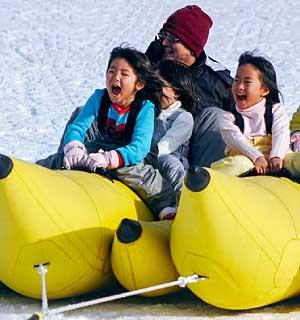 Snow activity winter banana boat snow rafting