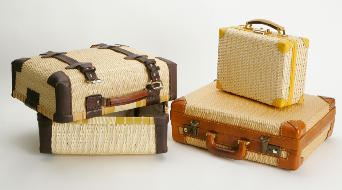 Three traditional Toyooka Kaban bags arranged neatly