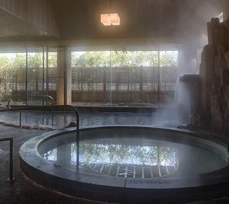 The steamy interior bathroom of Satonoyu Onsen