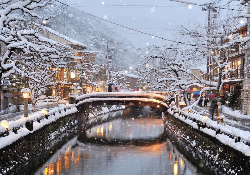 Kinosaki Onsen river and stone bridges during heavy snowfall