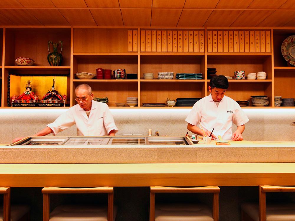 The chefs of Orizuru sushi restaurant preparing for guests.