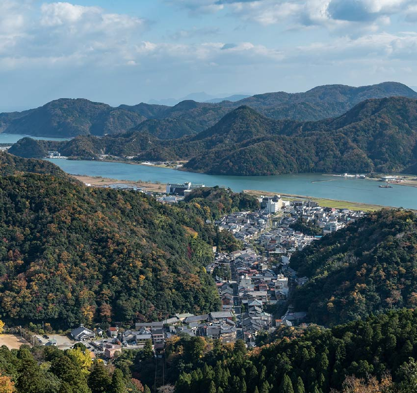 Kinosaki Onsen town and valley it sits in, taken from Mount Daishi on a sunny day