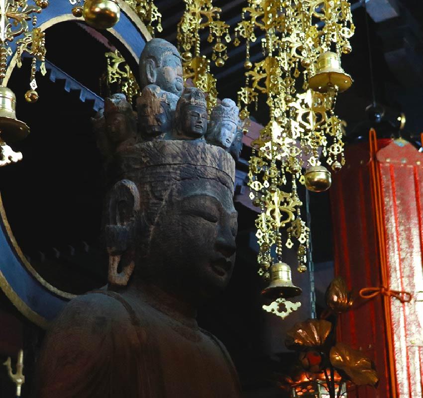 A closeup of a buddhist statue found inside Onsenji Temple