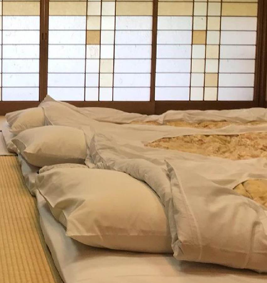 3 futons in a row on tatami floor