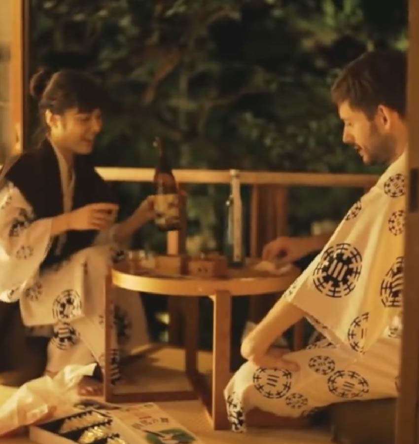 A couple enjoying sake together in Yukata on tatami floor in a private ryokan bedroom